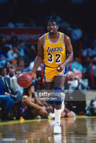 Earvin Magic Johnson of the Los Angeles Lakers dribbles the ball up court during an NBA basketball game circa 1987 at The Forum in Inglewood...