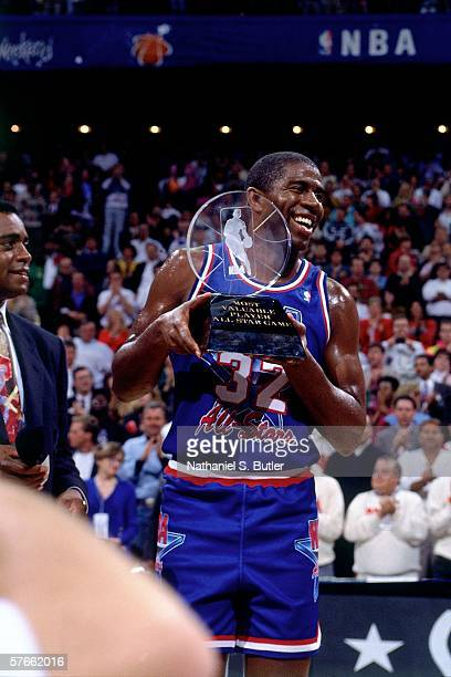 Earvin 'Magic' Johnson of the Western Conference All Stars is presented the 1992 NBA All Star Game MVP trophy on February 9 1992 at the Orlando Arena...