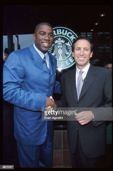 Earvin 'Magic' Johnson poses with Starbucks CEO Howard Schultz May 6 1999 in New York City Johnson won five championships and three Most Valuable...
