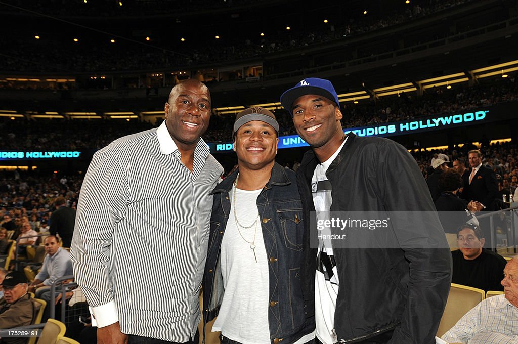 Earvin 'Magic' Johnson rapper LL Cool J and Kobe Bryant of the Los Angeles Lakers attend a game between the Los Angeles Dodgers and the New York...