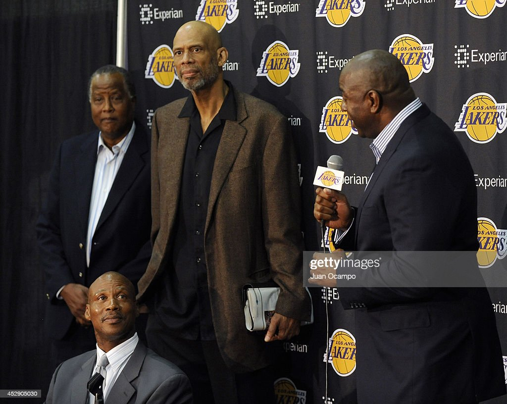 Earvin 'Magic' Johnson speaks to the media during a press conference to introduce <a gi-track='captionPersonalityLinkClicked' href=/galleries/search?phrase=Byron+Scott+-+Basketball+Coach&family=editorial&specificpeople=209087 ng-click='$event.stopPropagation()'>Byron Scott</a> as the new head coach of the Los Angeles Lakers on July 29, 2014 at Toyota Sports Center in El Segundo, California.