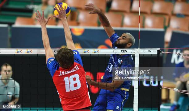 Earvin Ngapeth of France spikes the ball against Jakub Janouch of the Czech Republic during the playoff phase match between France and Czech Republic...