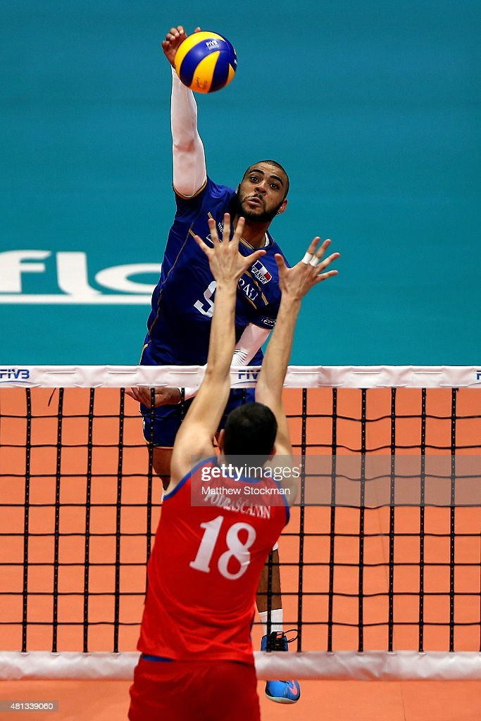 Earvin Ngapeth of France spikes the ball against <a gi-track='captionPersonalityLinkClicked' href=/galleries/search?phrase=Marko+Podrascanin&family=editorial&specificpeople=4037691 ng-click='$event.stopPropagation()'>Marko Podrascanin</a> of Serbia during the FIVB World League Group 1 Finals gold medal match between Serbia and France at Maracanazinho on July 19, 2015 in Rio de Janeiro, Brazil.