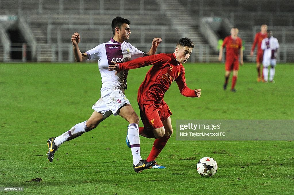 Easah Suliman of Aston Villa and Harry Wilson of Liverpool in action during the FA Youth Cup Fourth Round fixture between Liverpool and Aston Villa at Langtree Park on January 15, 2014 in St Helens, England.