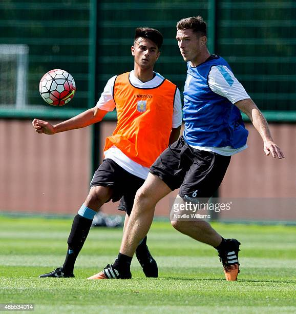 Easah Suliman of Aston Villa in action with team mate Ciaran Clark during a Aston Villa training session at the club's training ground at Bodymoor...