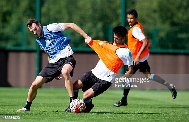 Easah Suliman of Aston Villa in action with team mate Libor Kozak during a Aston Villa training session at the club's training ground at Bodymoor...
