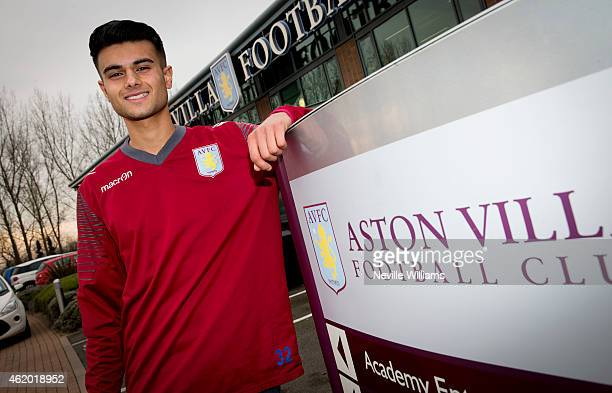 Easah Suliman of Aston Villa poses for a picture after signing his first professional contract at the club's training ground at Bodymoor Heath on...