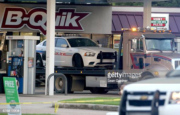 East Baton Rouge Police car is seen on a trailer as it is towed from the crime scene at the BQuik gas station on Airline Hwy after three police...