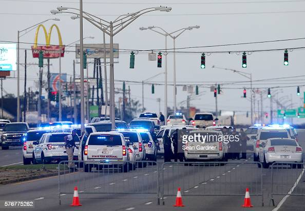 East Baton Rouge Police officers patrol Airline Hwy after 3 police officers were killed early this morning on July 17 2016 in Baton Rouge Louisiana...