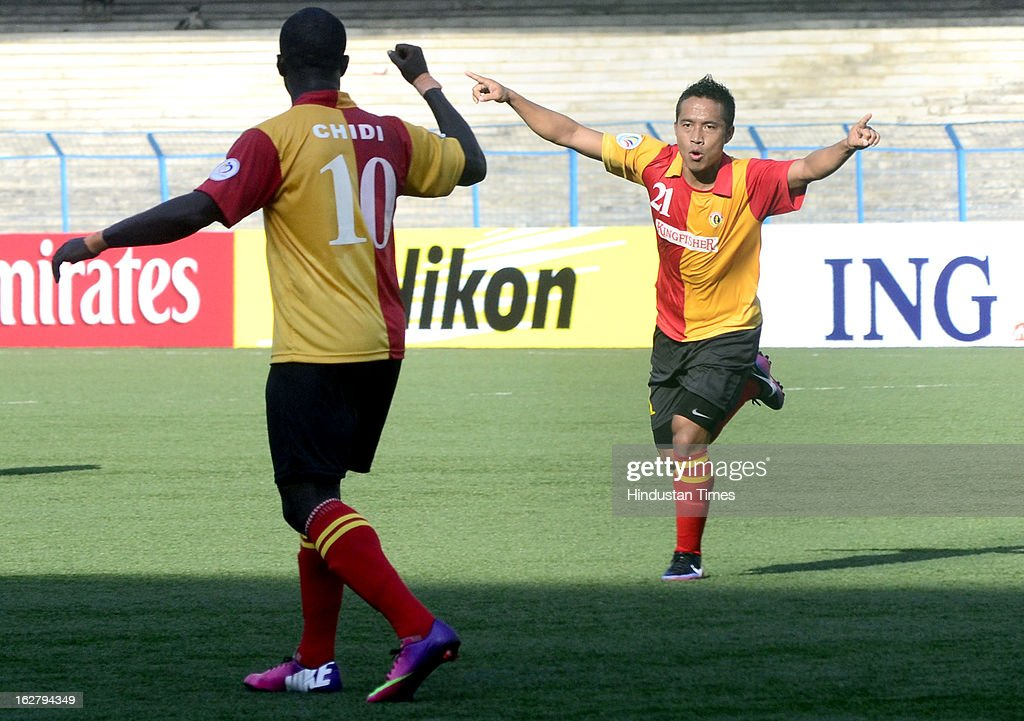 East Bengal player Lalrindika Ralte (21) celebrates with teammate Chidi (10) after scoring against Selangor of Malaysia during their AFC Football Cup 2013 at Yuba Bharati Krirangan, on February 27, 2013 in Kolkata, India.