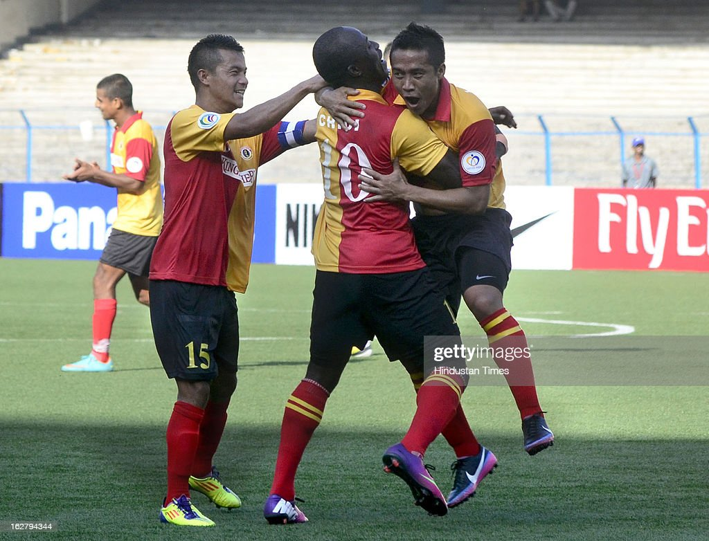 East Bengal player Lalrindika Ralte (21) celebrates with teammates Chidi (10) and Sanju after scoring against Selangor of Malaysia during their AFC Football Cup 2013 at Yuba Bharati Krirangan, on February 27, 2013 in Kolkata, India.