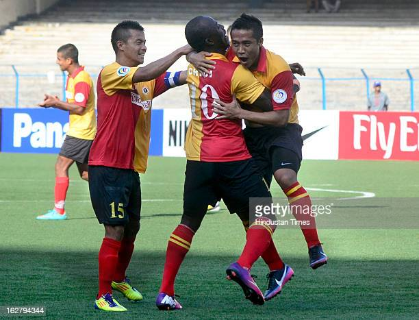 East Bengal player Lalrindika Ralte celebrates with teammates Chidi and Sanju after scoring against Selangor of Malaysia during their AFC Football...