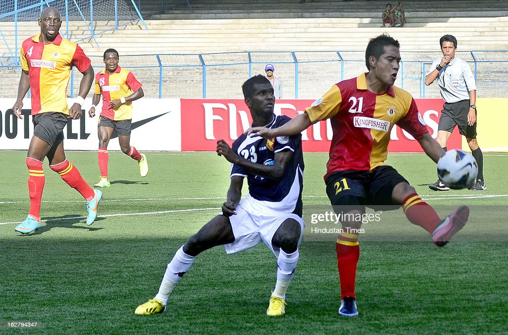 East Bengal player Lalrindika Ralte vying for ball with Selangor FC player during AFC Football Cup 2013 at Yuba Bharati Krirangan on February 27, 2013 in Kolkata, India.