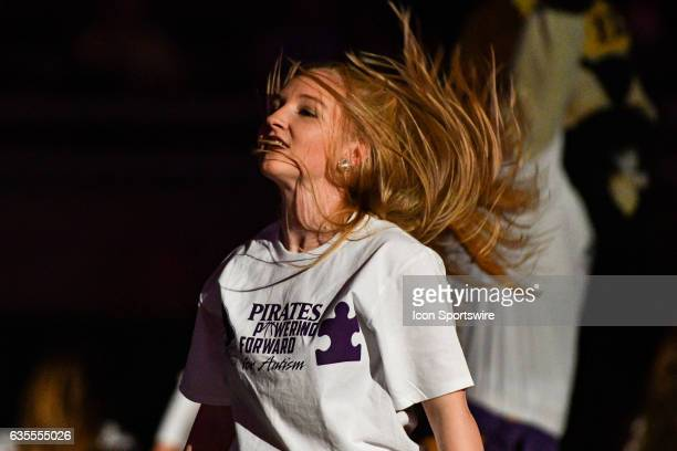 East Carolina Pirates cheerleaders perform in Pirates Powering Forward for Autism shirts before a regular season American Athletic Conference game...