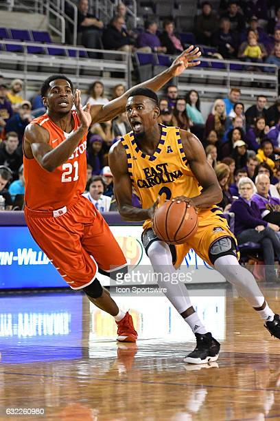 East Carolina Pirates guard Caleb White drives around Houston Cougars guard Damyean Dotson in an American Athletic Conference game between the East...