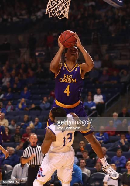 East Carolina Pirates Guard Elijah Hughes leaps over Tulsa Golden Hurricane Guard Jaleel Wheeler to get his shot off during the AAC Mens basketball...