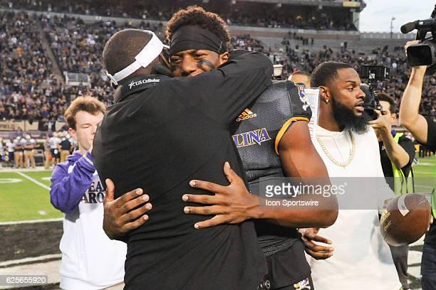 East Carolina Pirates head coach Scottie Montgomery and East Carolina Pirates wide receiver Zay Jones hug at midfield in a ceremony to honor the NCAA...