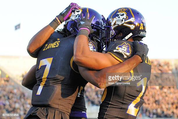 East Carolina Pirates wide receiver Zay Jones is congratulated after scoring a touchdown during an NCAA football game between the East Carolina...