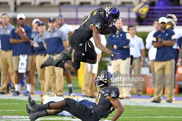 East Carolina Pirates wide receiver Zay Jones leaps East Carolina Pirates wide receiver James Summers after catching a pass during an NCAA football...