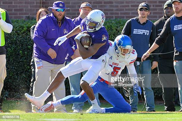 East Carolina Pirates wide receiver Zay Jones makes a catch over Southern Methodist Mustangs defensive back Jordan Wyatt during an NCAA football game...