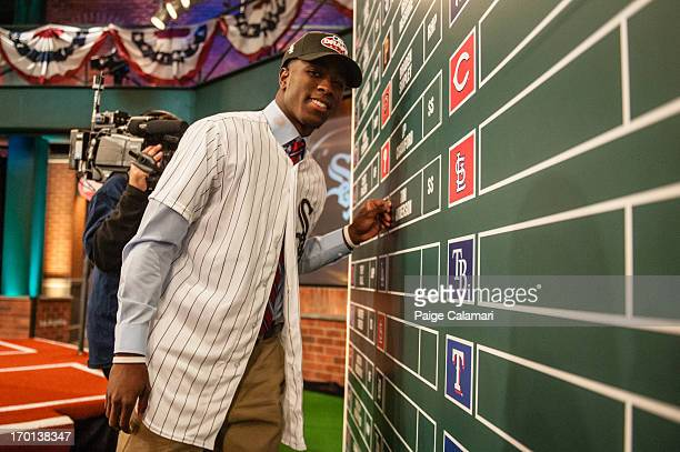 East Central Community College shortstop and 17th overall selection Tim Anderson places his name on the Draft board during the 2013 FirstYear Player...