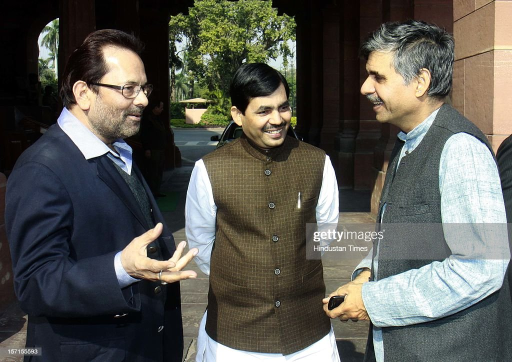 East Delhi MP Sandeep Dikshit (L) talking with BJP leaders Mukhtar Abbas Naqvi (R) and Syed Shahnawaz Hussain (C) at Parliament House after attending Parliament Winter Session on November 29, 2012 in New Delhi, India. The logjam in Parliament finally ended after government agreed to the voting on FDI issue. The voting after debate will be held next week on December 4 and 5.
