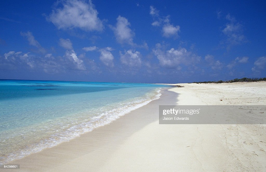 Rich turquoise seas and coral reefs surround remote tropical islands. : Stock Photo