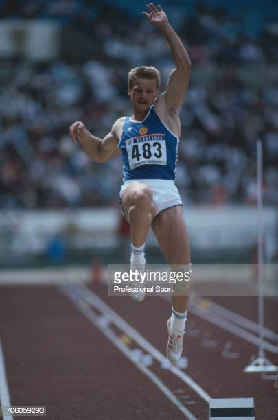 East German decathlete Torsten Voss competes in the long jump discipline on the first day of competition before finishing in 2nd place to win the...