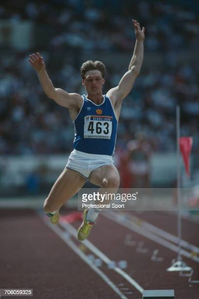 East German decathlete Uwe Freimuth competes in the long jump discipline on the first day of competition before finishing in 18th place in the Men's...