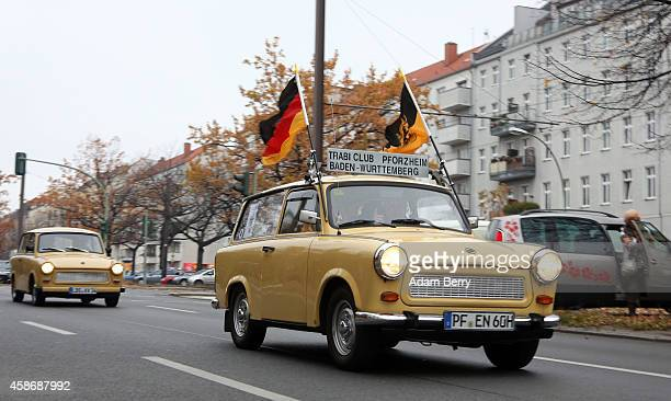 East German or German Democratic Republic era Trabant automobiles drive through Berlin during celebrations for the 25th anniversary of the fall of...