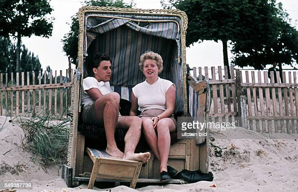 Summer at the Baltic Sea a couple in a wicker beach chair probably on Ruegen Island