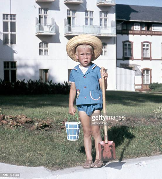 East Germany summer at the seaside little boy with a bucket and a shovel