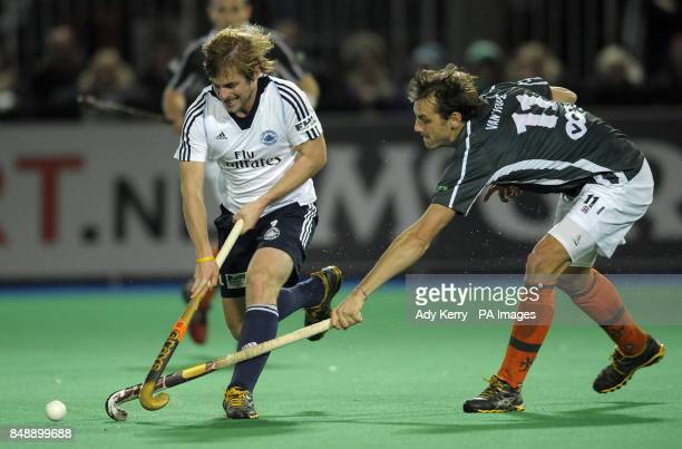 East Grinstead's Ashley Jackson controls the ball in front of Waterloo Ducks' Benjamin Van Hove during the EuroHockey League Round 12 game at East...