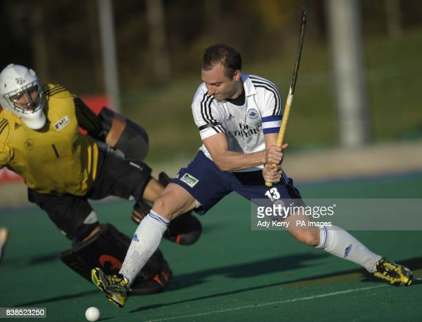 East Grinstead's Danny Hall shoots despite the attention of Beeston's George Pinner in goal during the Premier Division game at East Grinstead Hockey...