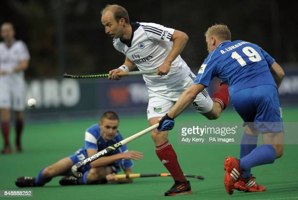 East Grinstead's Glenn Kirkham challenges with SC Stroitel Brest's Andrei Lukashyk during their EuroHockey League Round 12 game at East Grinstead HC...