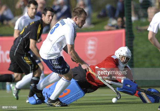 East Grinstead's Mark Pearn is challenged by Beeston's George Pinner during their England Hockey League Premier Division playoff final at Cannock...