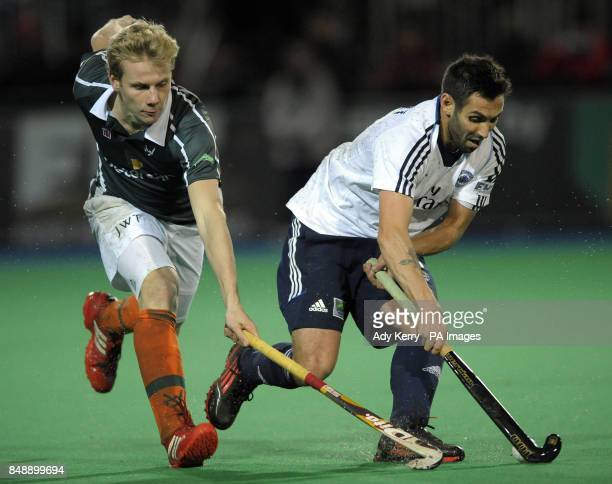 East Grinstead's Niall Stott controls the ball in front of Waterloo Ducks' Quentin Van Lierde during the EuroHockey League Round 12 game at East...