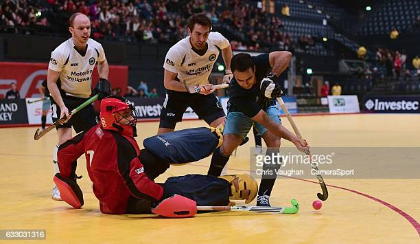 East Grinstead's Paddy Smith saves at the feet of Reading's Harry Jawanda during the Maxifuel Super Sixes Mens SemiFinal match between East Grinstead...