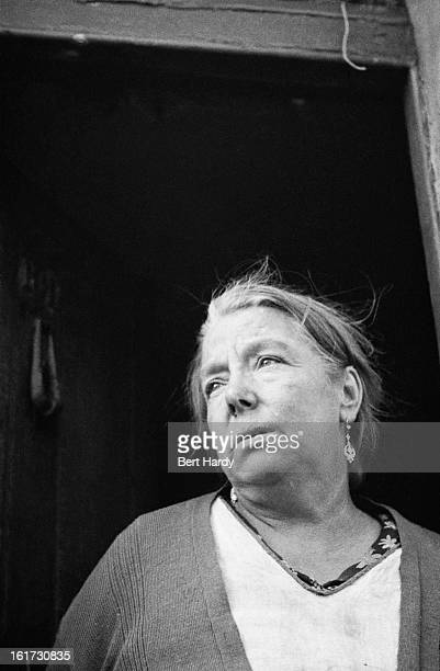 East Londoner Elizabeth Malpass whose home has been badly damaged by a German bombing raid in the first month of the Blitz September 1940 Original...