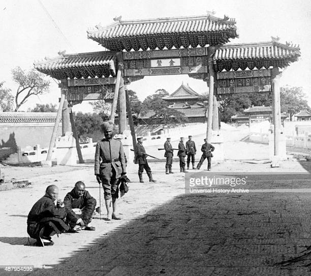 East over Marble Bridge toward the Forbidden City Peking 1901 photographic print on stereo card Indian soldiers and two Chinese men in front of a gate