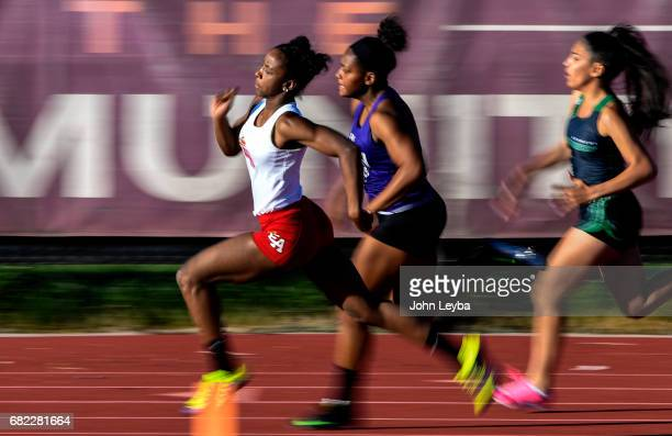 East phenom sprinter Arria Minor sprints around turn three in the 200 meter dash on May 11 2017 in Denver Colorado at South High School in the DPS...