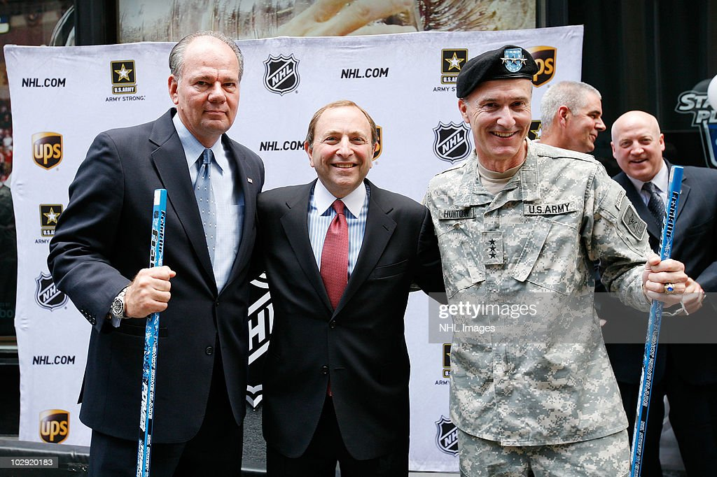 UPS East Region President Glenn Rice, NHL Commissioner <a gi-track='captionPersonalityLinkClicked' href=/galleries/search?phrase=Gary+Bettman&family=editorial&specificpeople=215089 ng-click='$event.stopPropagation()'>Gary Bettman</a> and Lt. Gen. David Huntoon, Jr. pose during the NHL, UPS & U.S. Army Street Hockey Equipment Donation To Troops In Iraq event at the NHL Powered by Reebok Store on June 7, 2010 in New York.