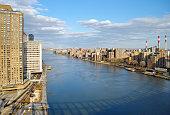 View of East River with shadow of the Queensboro Bridge from the Roosevelt Island Tramway.