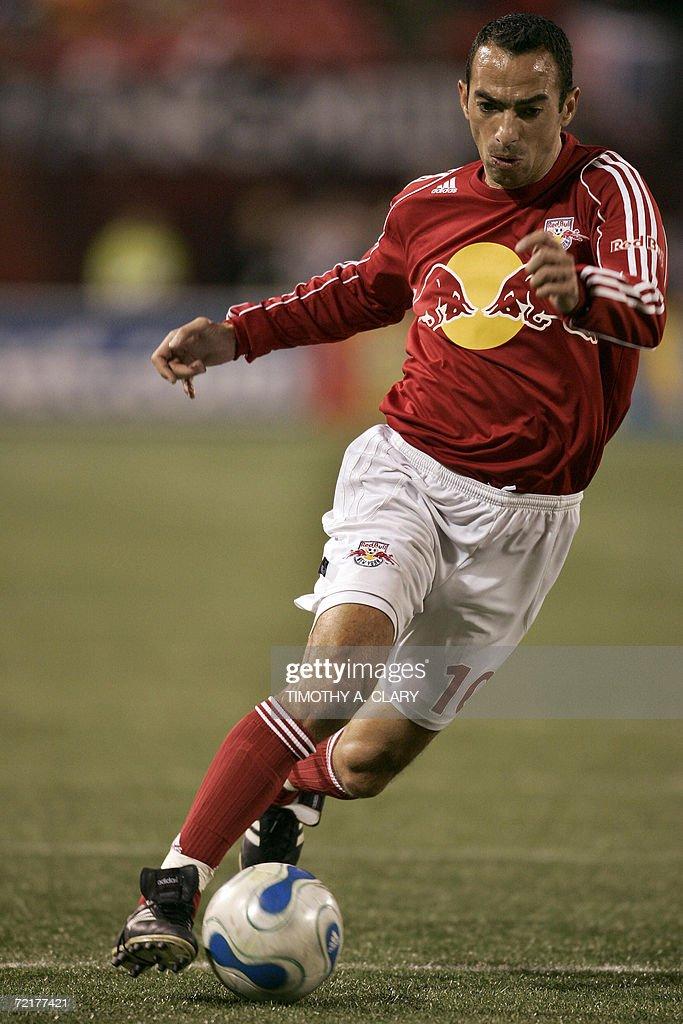 New York Red Bulls forward Youri Djorkaeff from Lyon France dribbles during the last game of the regular MLS season against the Kansas City Wizards...