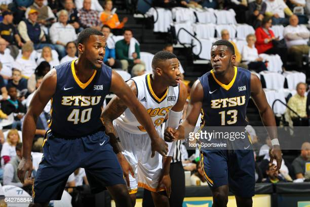 East Tennessee State Buccaneers forward Tevin Glass blocks out Chattanooga Mocs forward Tre' McLean during the first half of the college basketball...