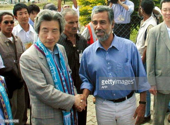 East Timor independence leader and presidentelect Xanana Gusmao shakes hand with Japanese Prime Minister Junichiro Koizumi during the latter's...