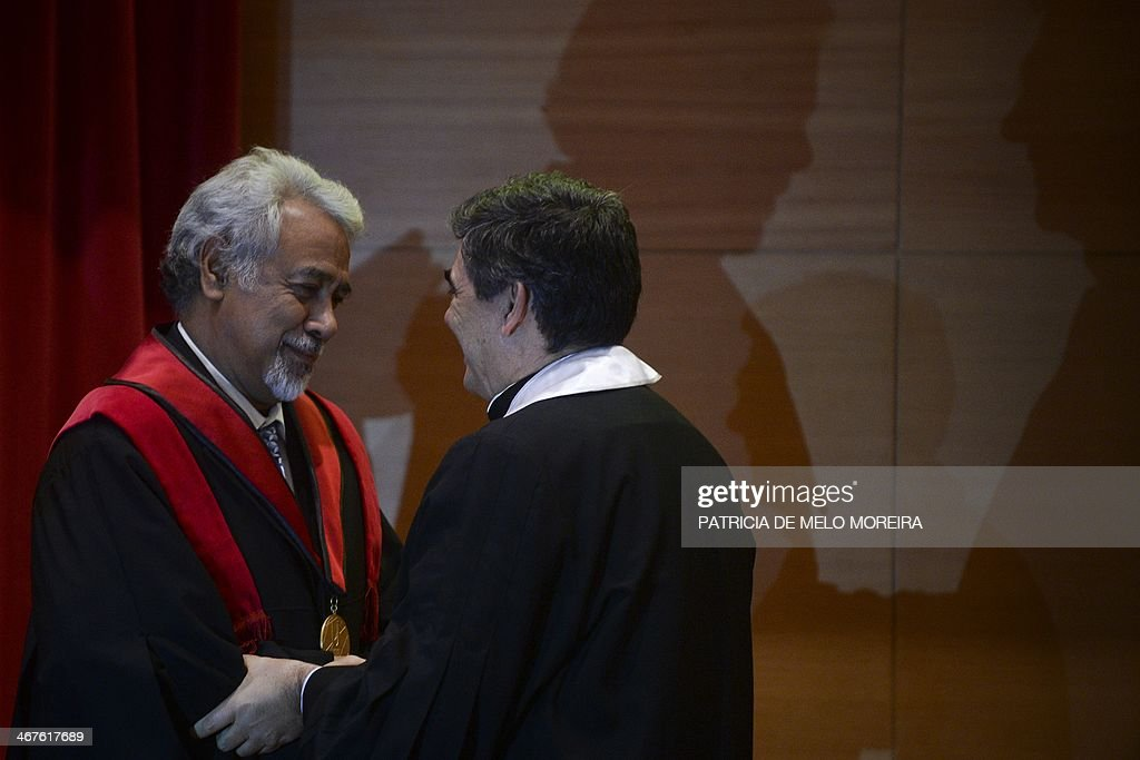 East Timor Prime Minister Kay Rala Xanana Gusmao (L) receives the Honoris Causa degree by the hand of the Rector Antonio Cruz Serra (R) during a ceremony at the University of Lisbon's School of Political Sciences in Lisbon on February 7, 2014. AFP PHOTO/ PATRICIA DE MELO MOREIRA