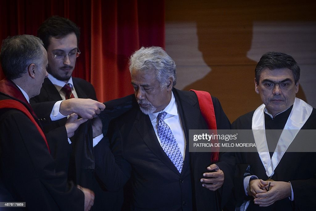 East Timor Prime Minister Kay Rala Xanana Gusmao (2ndR) receives the Honoris Causa degree during a ceremony at the University of Lisbon's School of Political Sciences in Lisbon on February 7, 2014. AFP PHOTO/ PATRICIA DE MELO MOREIRA