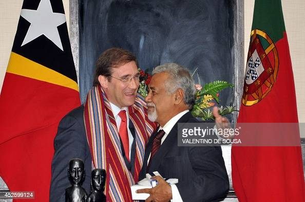 East Timor Prime Minister Xanana Gusmano gets a hug from his Portuguese counterpart Pedro Passos Coelho during a meeting on the sideline of the 10th...