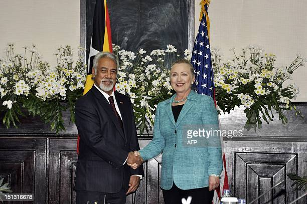 East Timor Prime Minister Xanana Gusmao shakes hands with US Secretary of State Hillary Clinton during her visit to Dili on September 6 2012 Clinton...